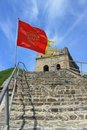 Red flag in the wind badaling section of the great wall china image a on a stretch remnant at editorial use only Royalty Free Stock Photos
