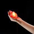 Red flaming candle in the hand Royalty Free Stock Photo
