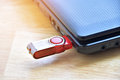 red flash drive in port usb with computer notebook. Royalty Free Stock Photo
