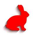 Blank red flat side silhouette of a rabbit with long shadow isolated on white background. Vector illustration.