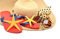 Red flip flops with starfishes, sunglasses and a seashell Royalty Free Stock Photo