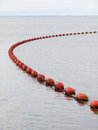 Red floating buoy with rope hanging swimming on water at a dam signate no entry zone for fisherman s boat Royalty Free Stock Photos