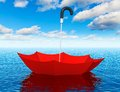 Red floating umbrella in the sea creative abstract help first aid insurance support and assistance corporate business concept blue Royalty Free Stock Image