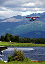 Red Floatplane Landing Royalty Free Stock Images