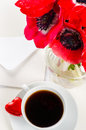 Red flowers, coffee and postcard Royalty Free Stock Image