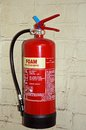 Red foam fire extinguisher. Royalty Free Stock Photo