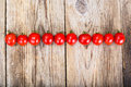Red Fresh Cherry Tomato on Wooden Rustic Background Royalty Free Stock Photo