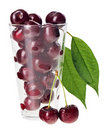 Red fresh wet cherry in transparent glass Stock Image