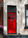 Red front door old house with Royalty Free Stock Photography