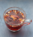 Red fruit tea in transparent glass Cup Royalty Free Stock Photo