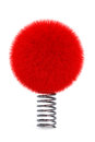 Red fur ball with spring on a white background Royalty Free Stock Photography