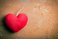 Red furry heart top view of on old cracked background Royalty Free Stock Photography