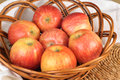 Red gala apples in a wicker plate Royalty Free Stock Image