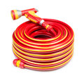 Red garden coiled hose with handle isolated on white Stock Photos