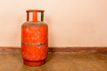 Red gas cylinder on pink Stock Photos
