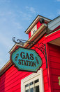Red gas station with flashy exterior in the blue sky Stock Images