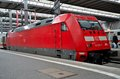 A red german electric railway engine parked at munich station train waits hauptbahnhof train the is part of deutsche bahn s fleet Royalty Free Stock Photos