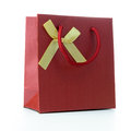 Red gift bag with ribbon isolated on white background Stock Photo