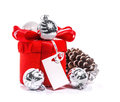 Red gift with bow and christmas balls isolate on white background Royalty Free Stock Photos