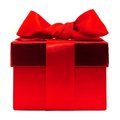 Red gift box with bow over a white background Royalty Free Stock Photography