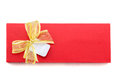 Red gift box with gold ribbon. Royalty Free Stock Photo