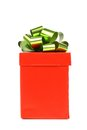Red gift box with green golden bow white background Royalty Free Stock Image
