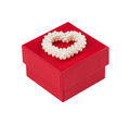 Red gift box with a heart of pearls; Clipping path Stock Images
