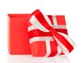 Red gift box with an open cover and the charming bow isolated on white Royalty Free Stock Photos