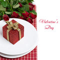Red gift box on a plate and roses isolated white Stock Photo