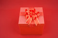 Red gift box on red backgroud for happy new year your wonderful day Stock Images
