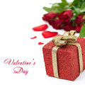Red gift box and roses in the background isolated on white Stock Photos
