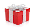 Red gift box with silver ribbon and bow isolated on white background Stock Image