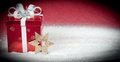 Red Gift Box In Snow Stock Photography
