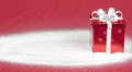Red Gift Box In Snow With Red Background Stock Photos