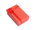 Red gift box with white red ribbon bow isolated on white backgro