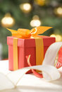 Red gift box and white transparent ribbon Stock Image