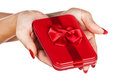 Red gift box in woman's hands Royalty Free Stock Images