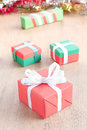 Red gift box on wood texture Royalty Free Stock Photo