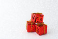 Red gift boxes in snow Stock Image