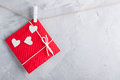 Red gift card wih paper hearts on gray concrete background. Royalty Free Stock Photo