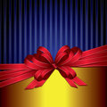 Red gift ribbon bow on gold and blue background Stock Images