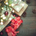 Red giftboxes in red decor under Cristmas tree in holiday eve. Boxing day. Copy space Royalty Free Stock Photo
