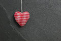 Red gingham love valentine s heart hanging on grey slate stone b background copy space Stock Photos
