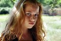 Red girl serious face near forest Stock Photography