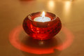 Red Glass Candle Holder with White Candle Royalty Free Stock Photo
