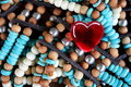 Red Glass Heart on Turquoise and Brown Beads Royalty Free Stock Photo