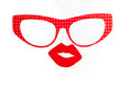 Red glasses and sexy lips pouting a vibrant set of colourful party accessories isolated on a white background Stock Image