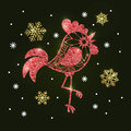Red glitter rooster and golden snowflakes on dark green background. Symbol of the Chinese New Year.