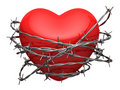 Red glossy heart surrounded by barbed wire Royalty Free Stock Photography
