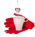 Red gloves and brewing tea infuser heart on a white background Stock Images